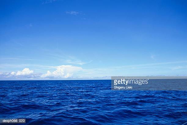 Surface of blue sea to clouds on horizon