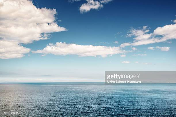 surface of calm sea on a sunny day - horizon stock pictures, royalty-free photos & images