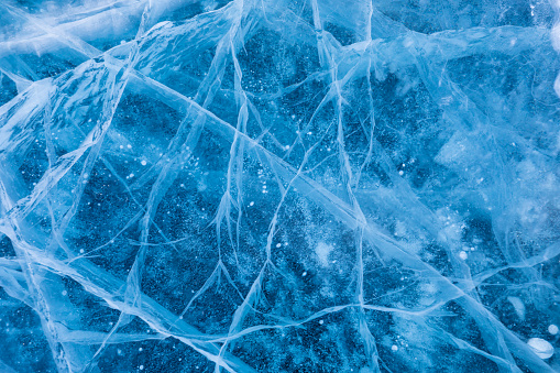 Surface of winter ice on Baikal lake in Siberia . Blue background of Ice texture - gettyimageskorea