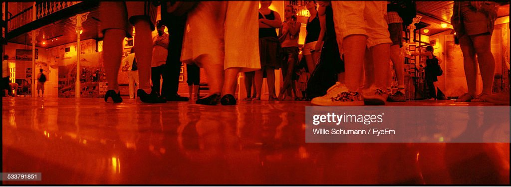 Surface View Of Floor With Low Section Of People Standing : Foto stock