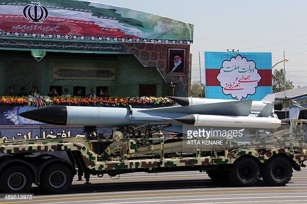 A S200 surfacetoair missile is driven past Iranian military commanders during the annual military parade marking the anniversary of the start of...