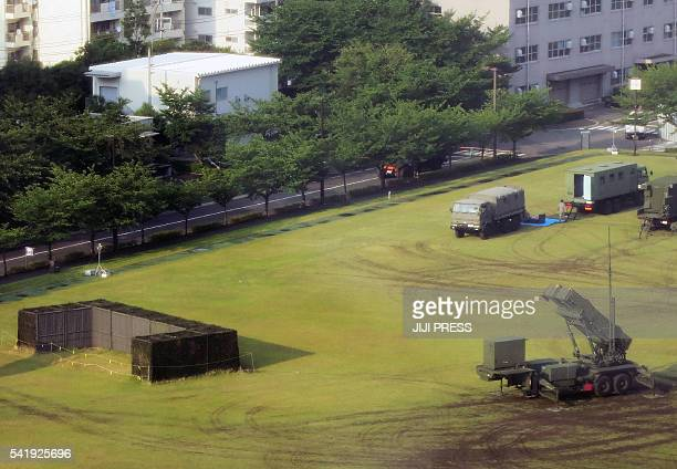 A PAC3 surfacetoair missile launcher system is seen deployed at the defence ministry grounds in Tokyo on June 21 following signs of a possible...