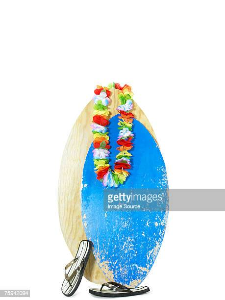 Surfboard flipflops and a garland of flowers