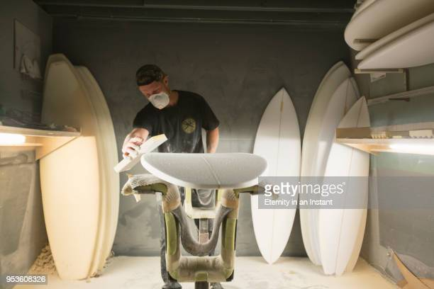 surfboard shaper making a surfboard in his workshop - molding a shape stock pictures, royalty-free photos & images