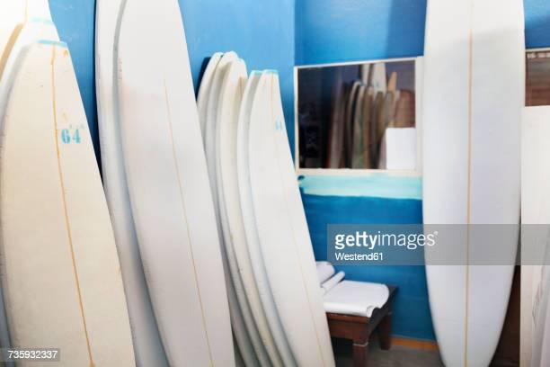 Surfboard shaper workshop, surfboards stacked in storeroom