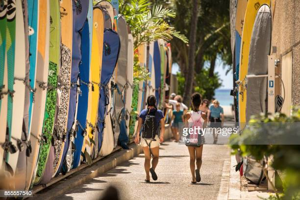 surfboard storage on the way to the beach oahu hawaii usa - waikiki stock pictures, royalty-free photos & images