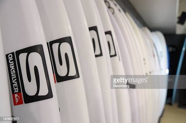 Surfboards are displayed for sale at the Quiksilver Inc store in Torquay Australia on Saturday Sept 22 2012 The surfwear brands Rip Curl Group Pty...