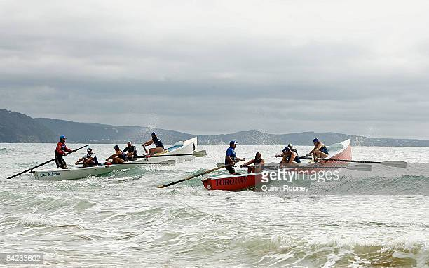 Surfboats compete before the start of the Lorne Pier To Pub open water swim at Louttit Bay January 10 2009 in Lorne Australia The Lorne Pier to Pub...