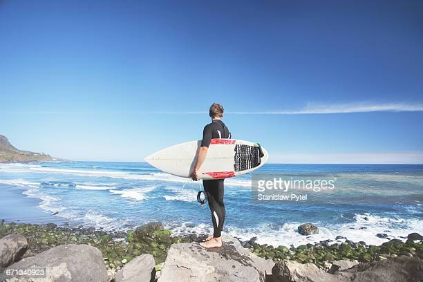Surfer against ocean
