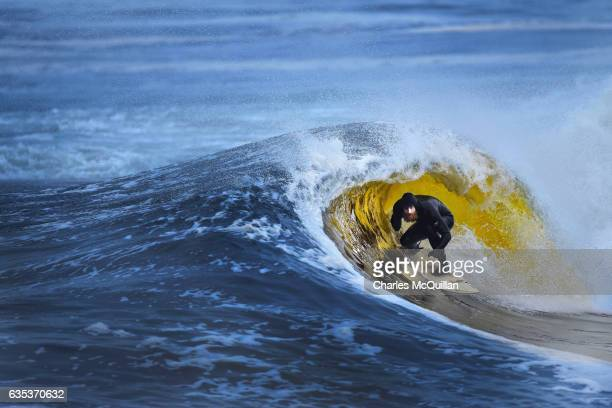 Surfer Al Mennie catches a golden barrel on January 12 2017 in Portballintrae Northern Ireland The position of the turf rich River Bush which runs...