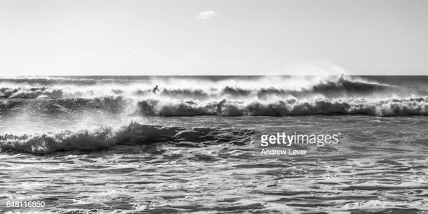 Surfer amongst waves.