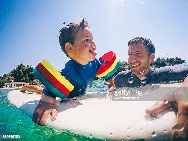 Surfer and his boy
