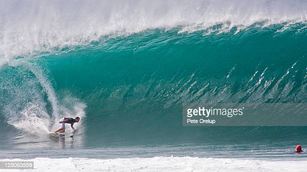 surfer and surf photographer at pipeline - banzai pipeline stock photos and pictures
