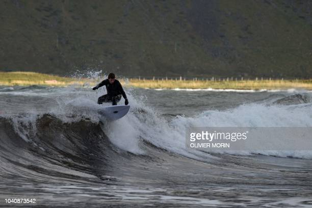 Surfer Anker Olsen Frantzen of Norway surfs during a free surf session on September 26 in Flakstad northern Norway at the eve of the Lofoten Masters...