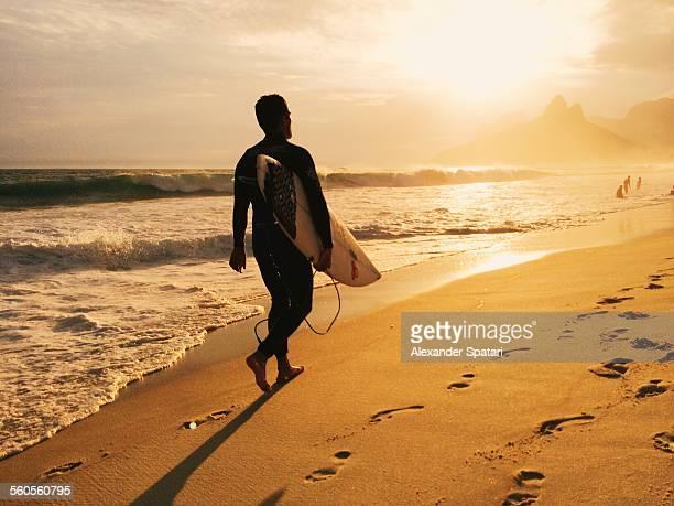 Surfer at Ipanema beach in Rio De Janeiro