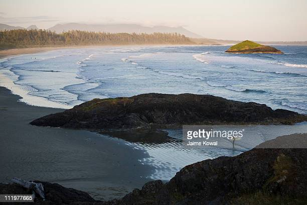 surfer at long beach, tofino, bc canada - vancouver island stock pictures, royalty-free photos & images