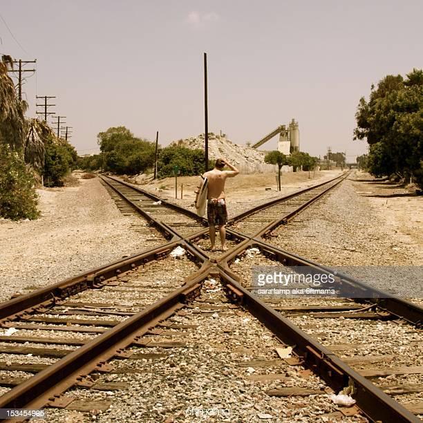 surfer at railway tracks - sara stone fotografías e imágenes de stock