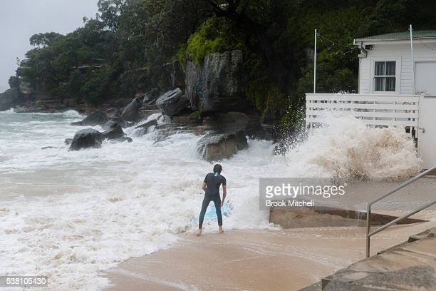 A surfer at Shark Beach Vaucluse on June 5 2016 in Sydney Australia Located inside Sydney harbour the rarely surfed waves at Shark beach have been...