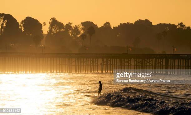 Surfer at sunrise, Ventura California, USA