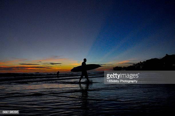 Surfer at sunset in La Libertad, El Salvador