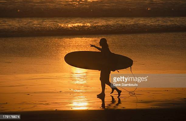 Surfer at sunset on Kuta Beach in Bali Indonesia