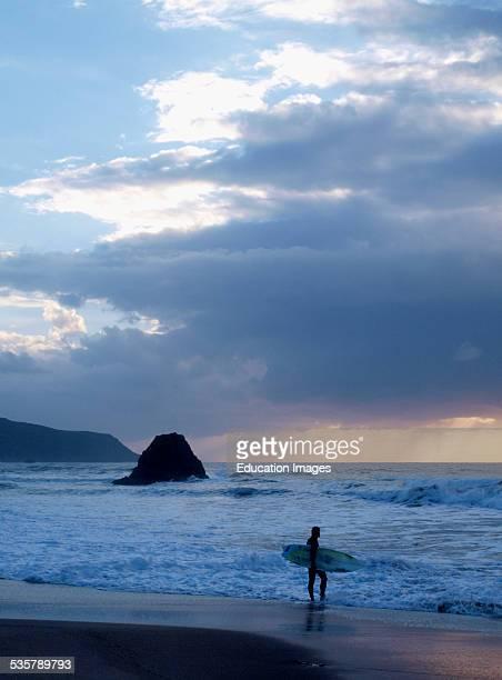 Surfer at sunset Widemouth Bay Bude Cornwall UK