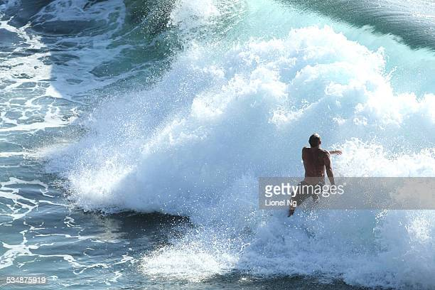 Surfer at Tamarama Beach in Sydney Mega Waves