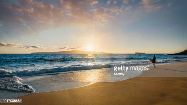 surfer at the beach maui island sunset panorama hawaii usa - romantic sunset stock pictures, royalty-free photos & images