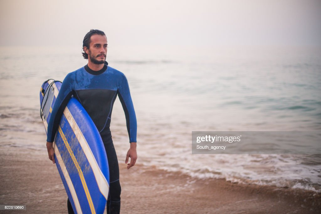 Surfer at the beach : Stock Photo