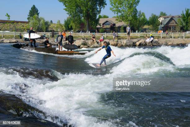 surfer at the bend,oregon colorado whitewater park - bend oregon stock photos and pictures