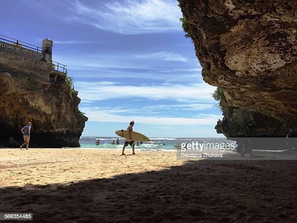 A surfer at Uluwatu beach Bali