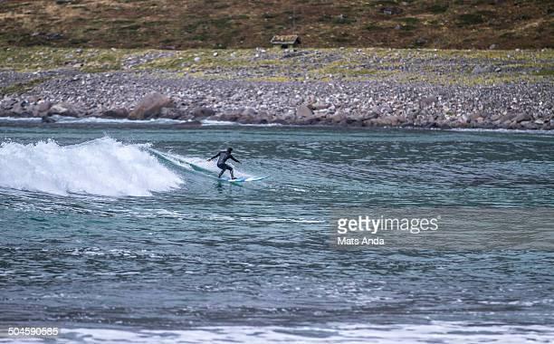 surfer at unnstad beach in lofoten - lofoten stock pictures, royalty-free photos & images