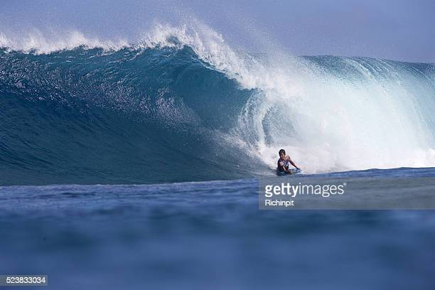 surfer bottom turns on a right wave - big bottom stock pictures, royalty-free photos & images