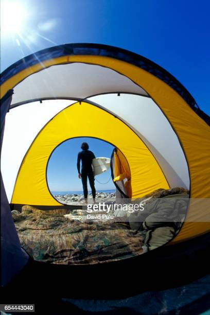 Surfer Camping on Beach