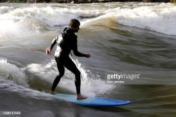 Surfer catches a standing wave on the Trinity River on March 19, 2020 in Fort Worth, Texas. Local surfers searched out standing waves in flooded...