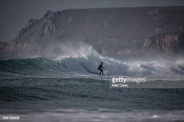 A surfer catches a wave as the sun sets over Sennen Cove on April 9 2015 in Cornwall England Prime Minister David Cameron has said that the six seats...