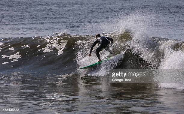 A surfer catches a wave at Will Rogers State Beach on March 3 in Santa Monica Beach California Millions of tourists flock to the Los Angeles area to...