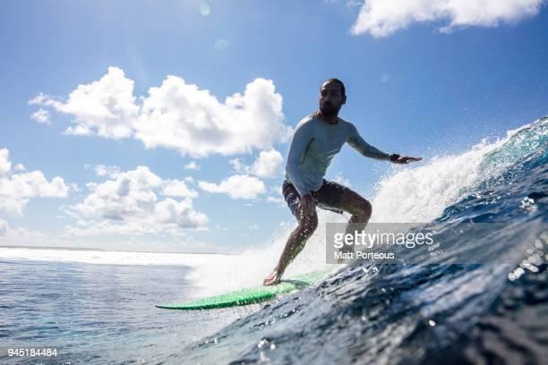 Surfer catches a wave