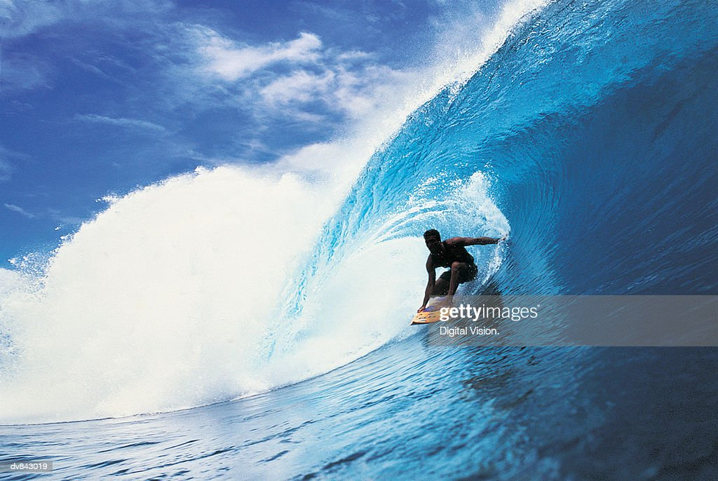 Surfer Catching a Wave : Stock Photo