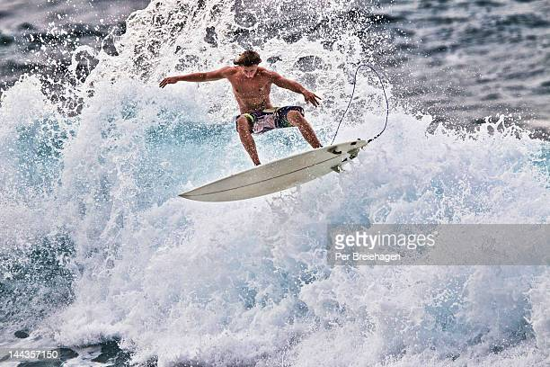 Surfer catching big  air in Maui