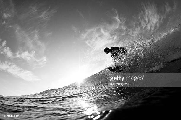 Surfer catching wave