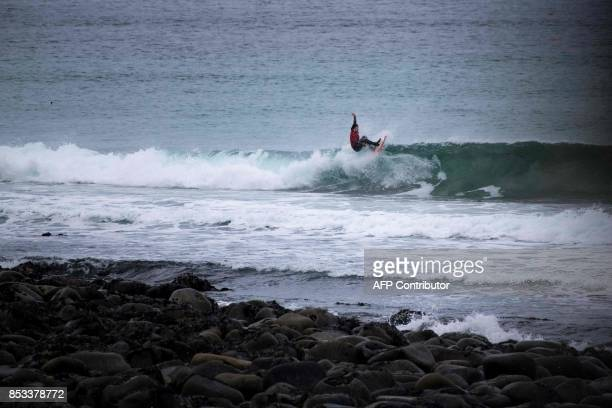 A surfer competes during the Lofoten Masters 2017 the northernmost surf contest in the world on September 23 2017 in Unstad's Bay in the Arctic...