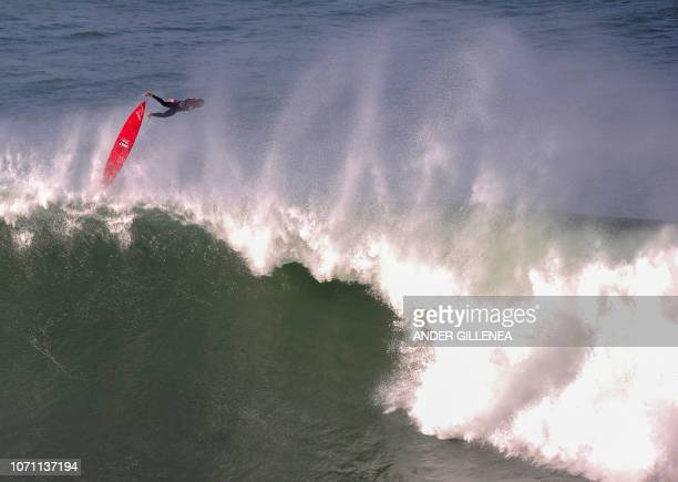 TOPSHOT A surfer competes during the Punta Galea Challenge big wave surfing competition in the Northern Spanish city of Getxo on December 10 2018