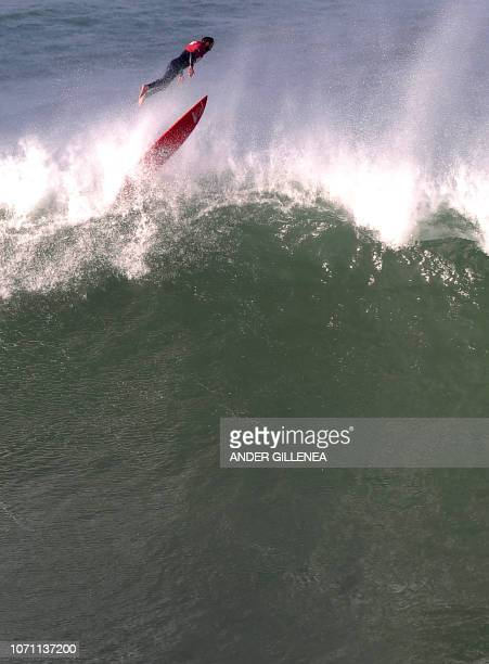A surfer competes during the Punta Galea Challenge big wave surfing competition in the Northern Spanish city of Getxo on December 10 2018