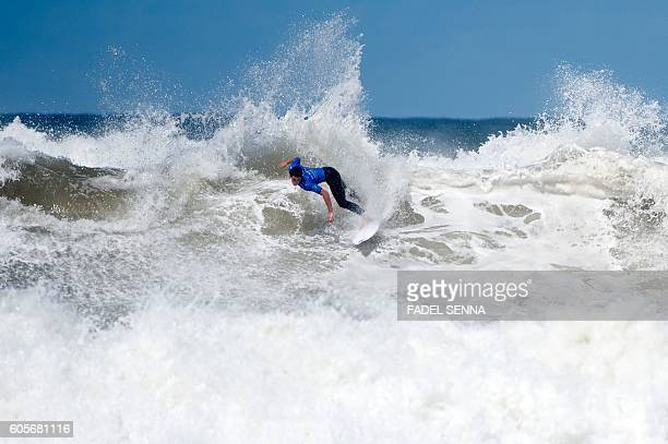 TOPSHOT A surfer competes in the water in the men's qualifying series at the Quiksilver Pro Casablanca surf competition on September 14 2016 in...