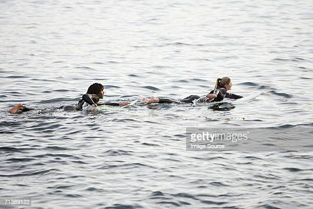 Surfer couple in the sea