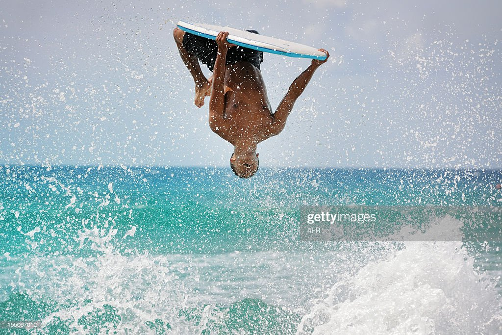 Surfer doing a backflip : Stock Photo