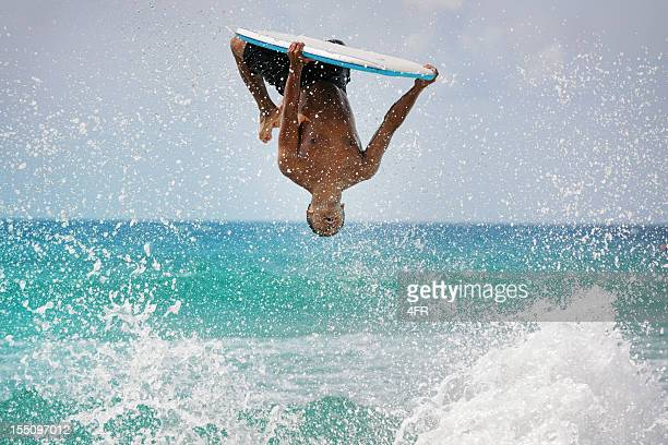 Surfer doing a backflip