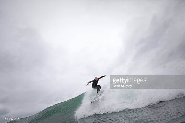 Surfer dropping in to wave