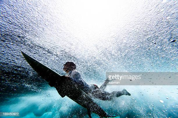 surfer duck diving - surf stock pictures, royalty-free photos & images